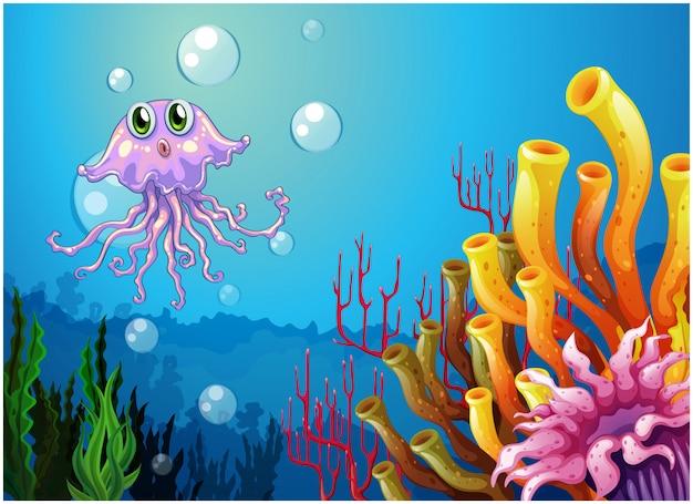 Um polvo e os recifes de coral sob o mar Vetor grátis