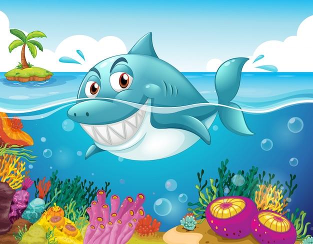 Um tubarão no mar com corais Vetor Premium