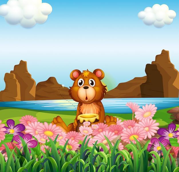 Um urso bonito perto das flores na margem do rio Vetor Premium