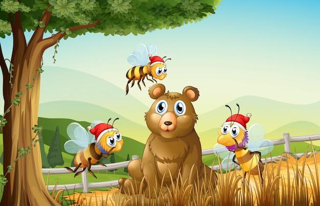 Um urso na floresta com três abelhas de santa Vetor grátis