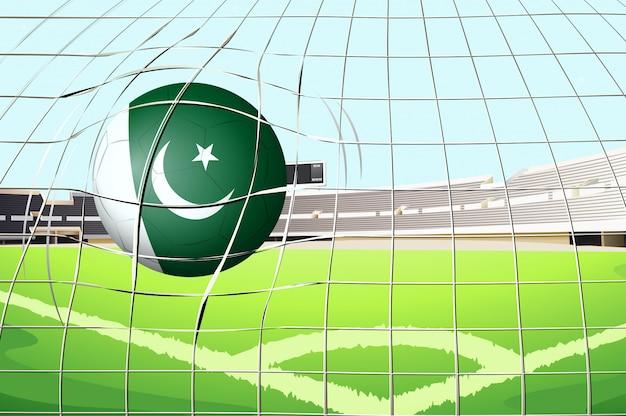 Uma bola acertando um gol com a bandeira do paquistão Vetor Premium