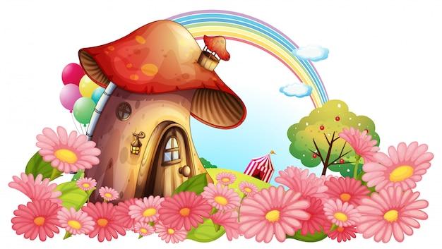 Uma casa de cogumelos com um jardim de flores Vetor Premium