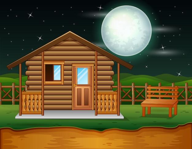 Uma casa de madeira tradicional na cena da noite Vetor Premium