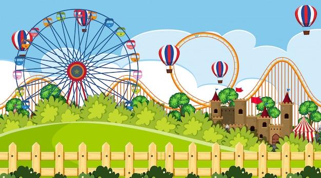 Uma cena ao ar livre com parque de diversões Vetor Premium