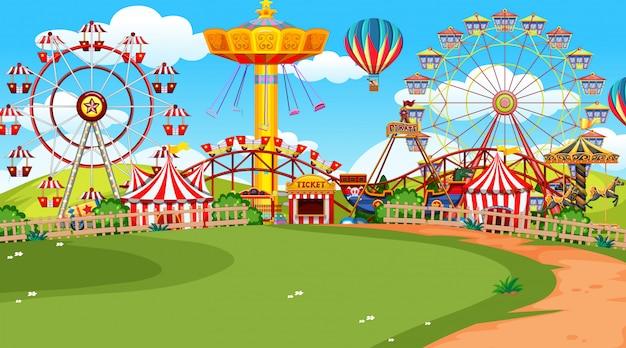 Uma cena de parque de diversões Vetor grátis