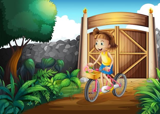 Uma criança andando de bicicleta no quintal Vetor grátis
