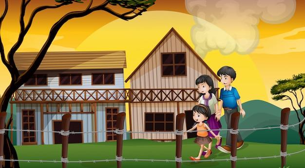 Uma família andando na frente das casas de madeira Vetor grátis
