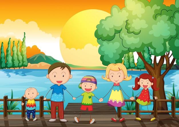 Uma família feliz na ponte de madeira Vetor grátis