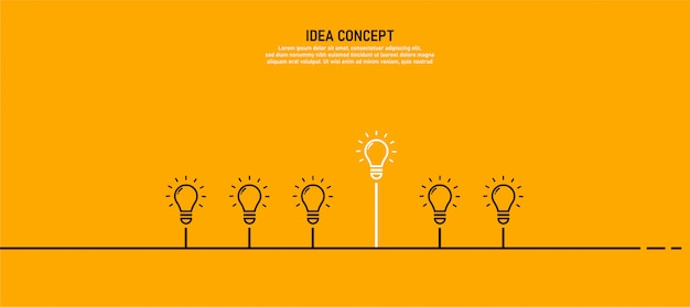 Uma lâmpada com uma luz é o conceito de lâmpada de sucesso Vetor Premium