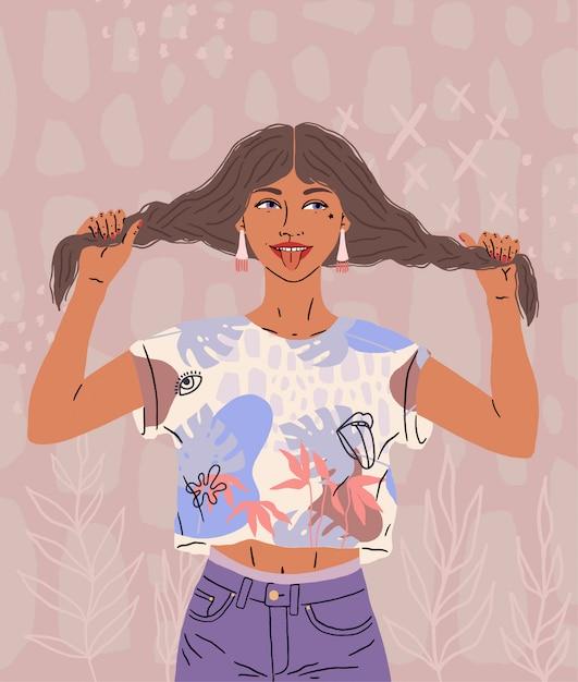 Uma linda garota feliz mostra a língua. uma mulher engraçada de bom humor segura o cabelo, duas tranças Vetor Premium