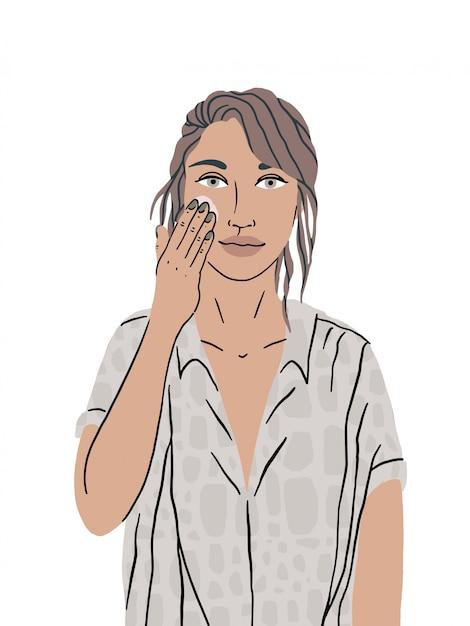 Uma linda garota se importa com a pele do rosto. mulher mancha creme para o rosto, limpeza e hidratação da pele. procedimentos higiênicos, autocuidado diário. ilustração isolada em um fundo branco. Vetor Premium