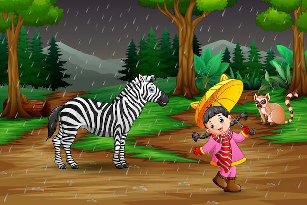 Uma menina brincando com animais sob a chuva Vetor Premium