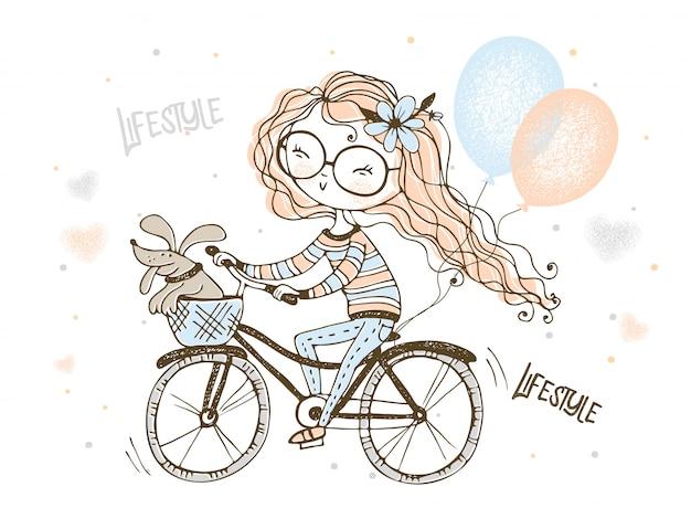 Uma menina com seu cachorro de estimação anda de bicicleta com balões. Vetor Premium
