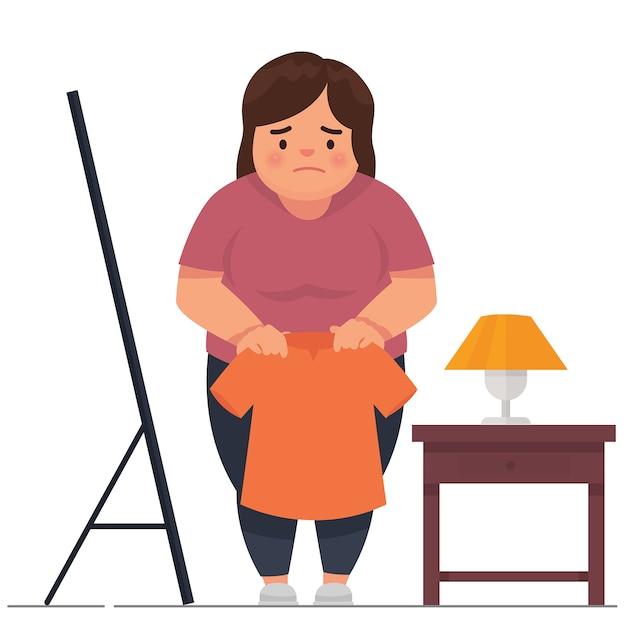 Uma menina gorda triste porque suas roupas eram muito pequenas Vetor Premium