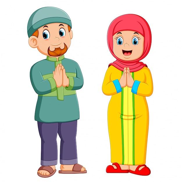 Uma mulher e um homem estão dando a saudação de perdão de mubarak ied Vetor Premium