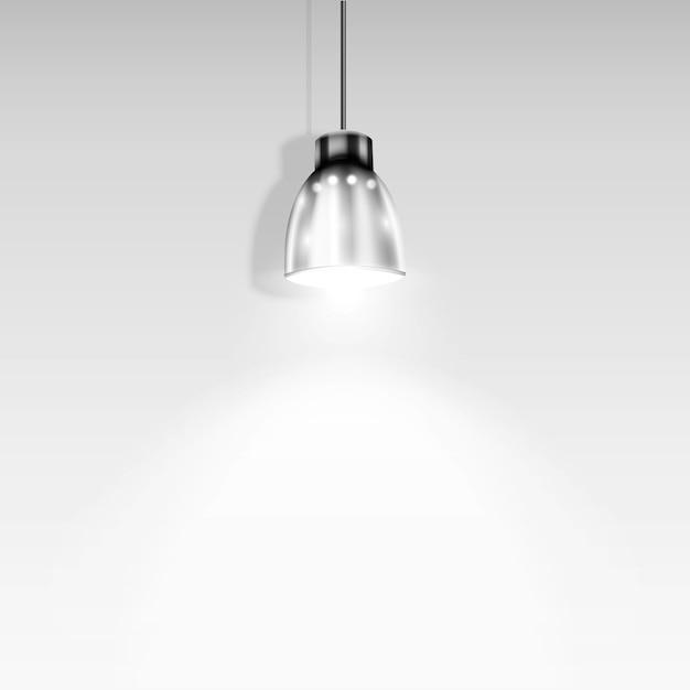 Único spotlight iluminando parede branca Vetor Premium