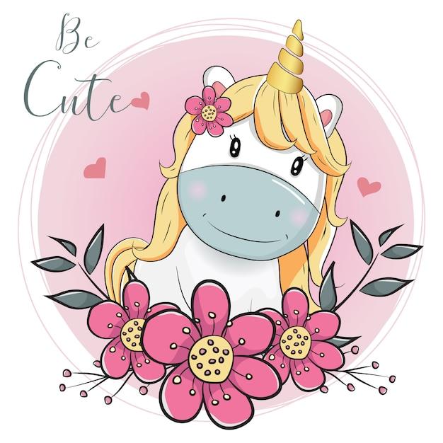 Unicórnio bonito dos desenhos animados com flores com fundo rosa Vetor Premium