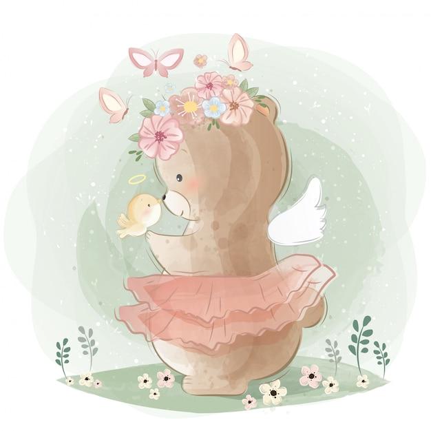 Urso angélico e um passarinho Vetor Premium