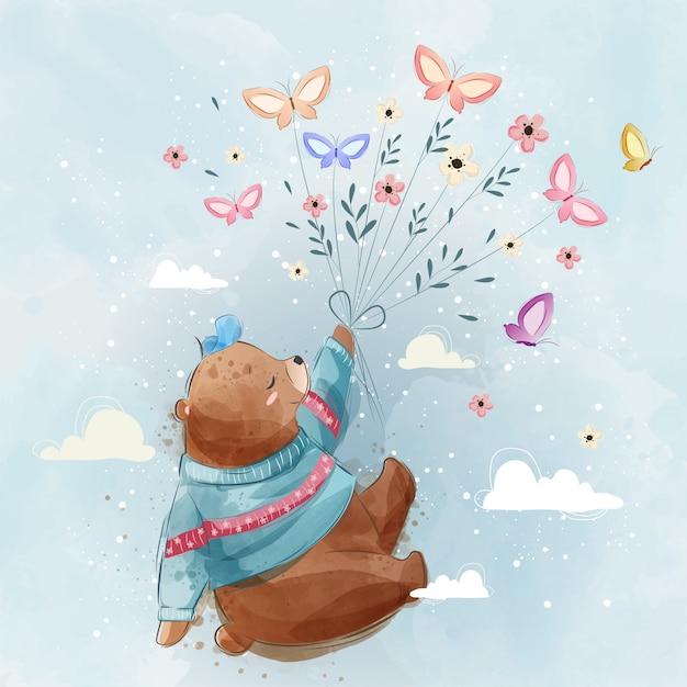 Urso voador com borboletas Vetor Premium