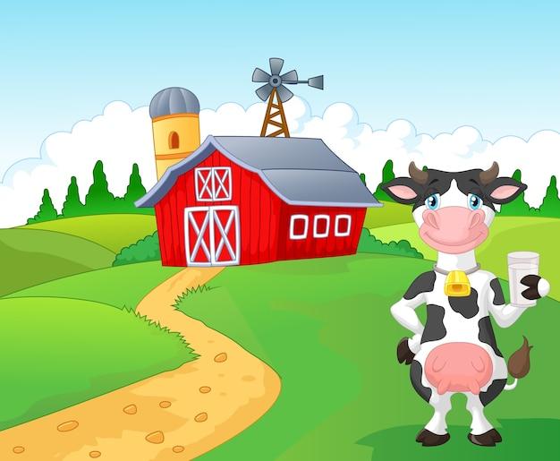 Vaca de desenhos animados segurando um copo de leite com fundo de fazenda Vetor Premium