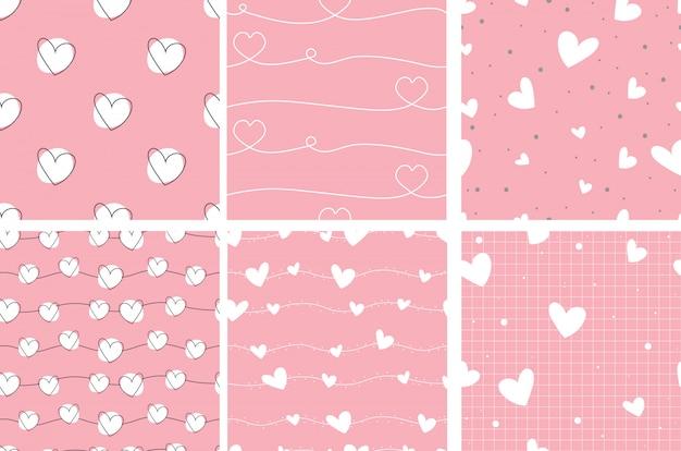 Valentine rosa doodle coração sem costura padrão coleção Vetor Premium