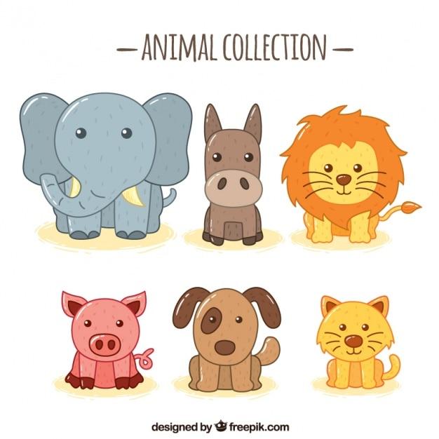 Variedade de animais fantásticos desenhados à mão Vetor grátis