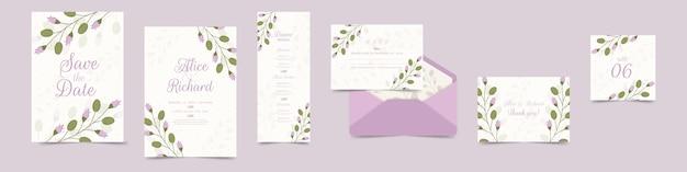 Variedade de artigos de papelaria de casamento floral em violeta Vetor grátis
