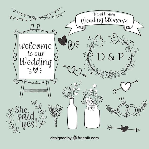 Variedade de itens de casamento desenhados à mão Vetor grátis
