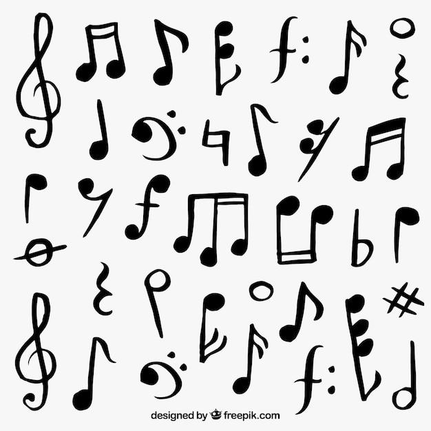 Variedade de notas musicais desenhados à mão Vetor grátis