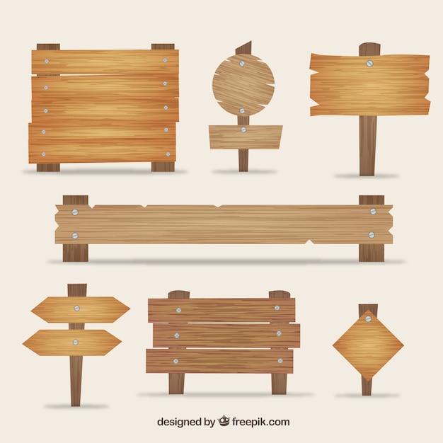 Variedade de placas de sinalização de madeira Vetor grátis