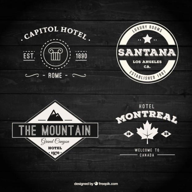 Variedade de retro emblemas de hotéis Vetor grátis