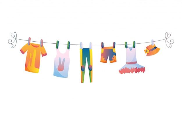 Vários itens de roupas de bebê na ilustração de corda isolada no fundo branco. Vetor Premium