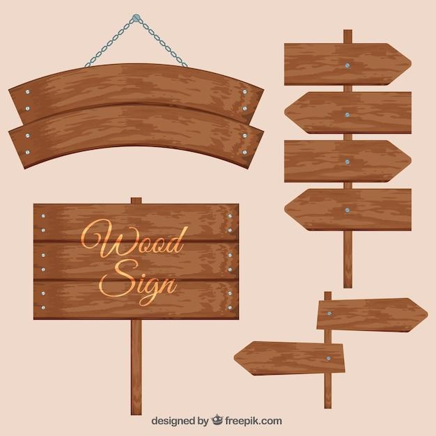 Vários sinais de madeira Vetor grátis