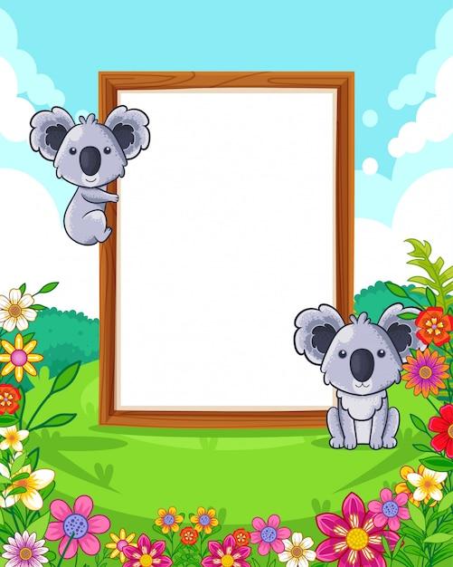 Vector a ilustração de coalas bonitos com sinal em branco de madeira no parque Vetor Premium