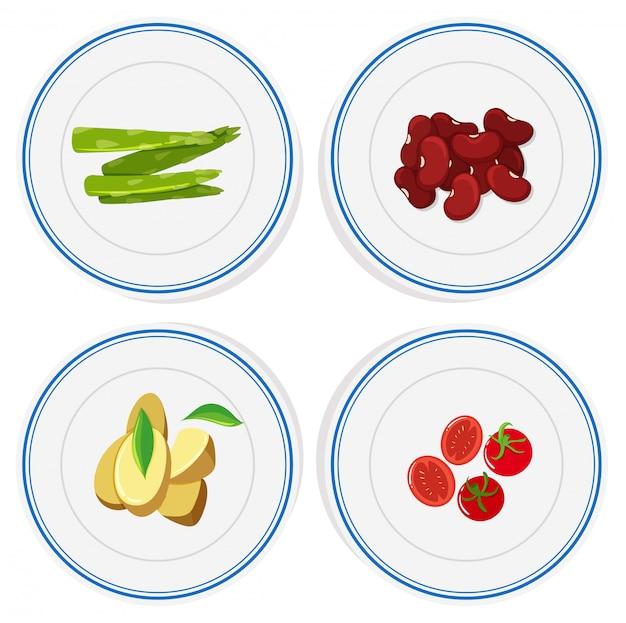 Vegetais diferentes em placas redondas Vetor grátis