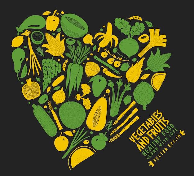 Vegetais e frutas dispostos em forma de coração Vetor Premium