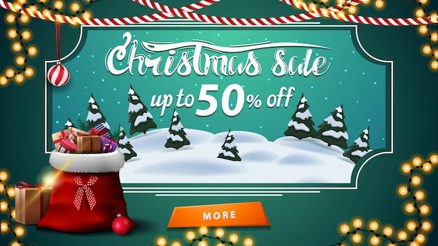 Venda de natal, desconto de até 50%, banner de desconto verde com paisagem de inverno dos desenhos animados Vetor Premium