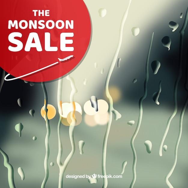 Venda de temporada de monção com fundo desfocado Vetor grátis