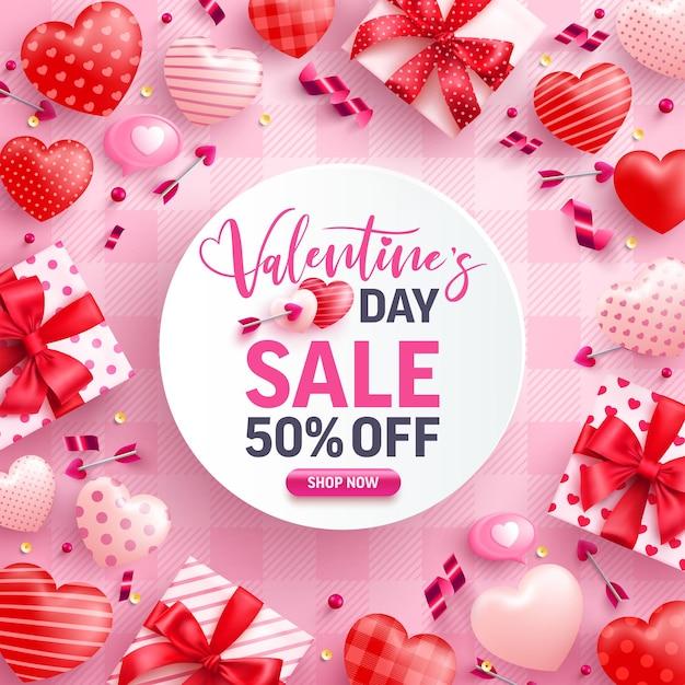 Venda do dia dos namorados com 50% de desconto em banner com caixa de presente fofa, corações doces e elementos de dia dos namorados em rosa Vetor Premium
