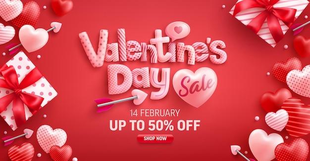Venda do dia dos namorados com 50% de desconto em banner com caixa de presente fofa e corações doces em vermelho Vetor Premium