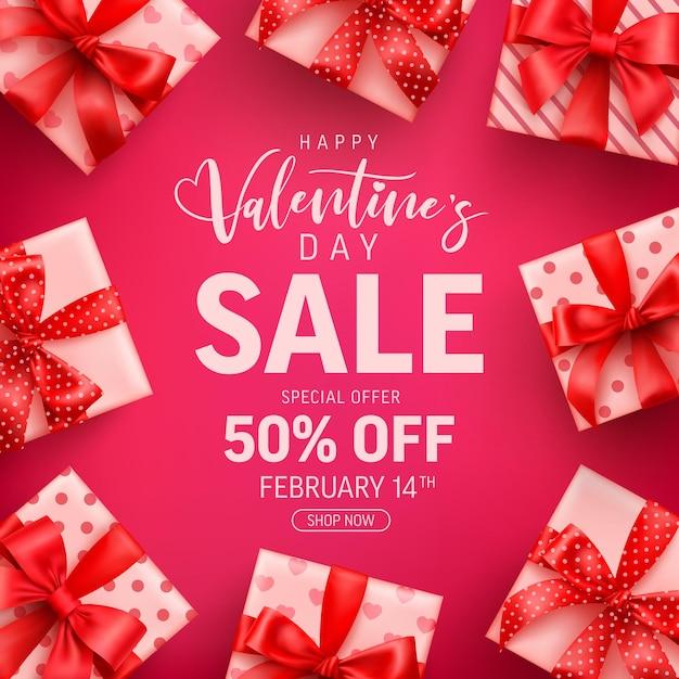 Venda do dia dos namorados com 50% de desconto em uma linda caixa de presente rosa Vetor Premium