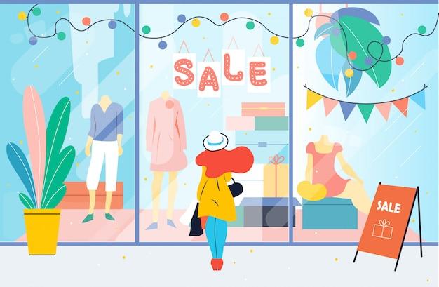 Venda. menina olha para a janela da loja de roupas. mulher em pé perto de vitrine no shopping. desconto Vetor Premium