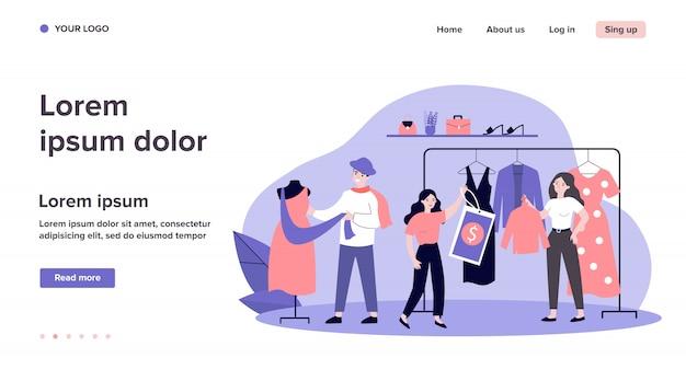 Vendedores de lojas e assistência pendurando roupas Vetor Premium