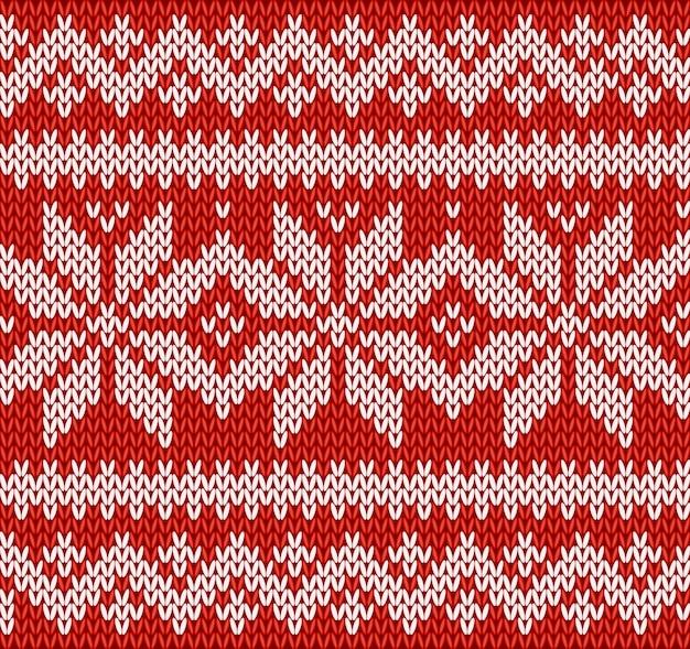 Vermelho e branco de tricô sem costura padrão com flocos de neve Vetor Premium