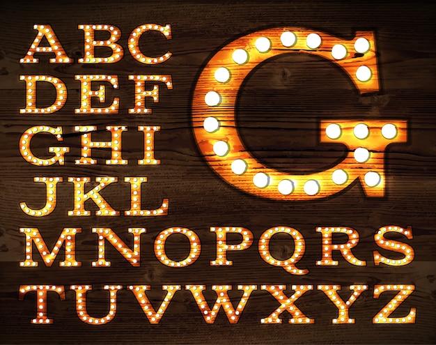 Vetor de cartas no alfabeto de lâmpada velha estilo retro Vetor Premium