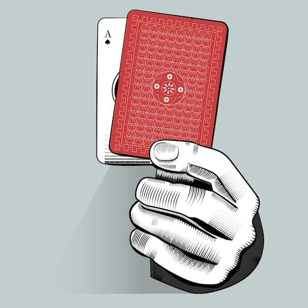 Vetor de mão segurando o cartão de jogo aleatório Vetor grátis