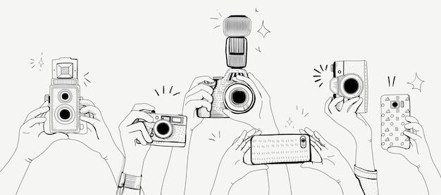 Vetor de mãos tirando fotos Vetor grátis