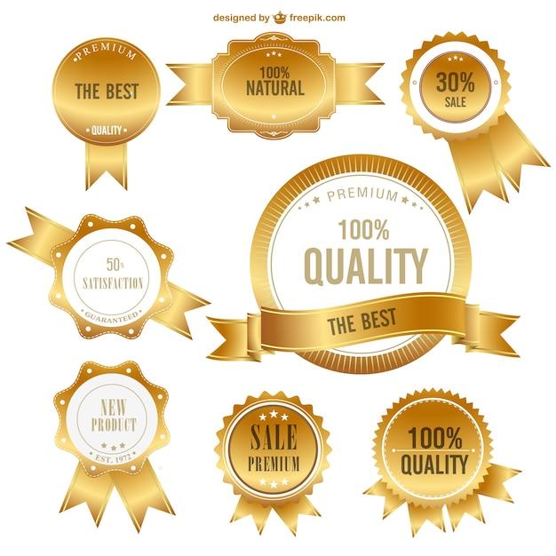 Vetor emblemas de primeira qualidade de ouro Vetor Premium