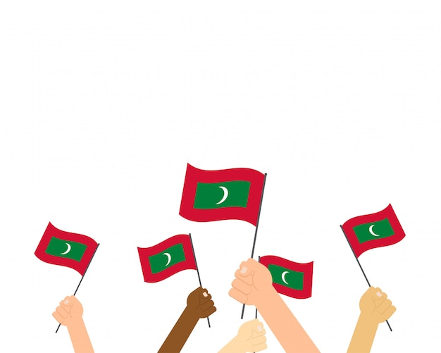 Vetorial, ilustração, de, mãos, segurando, maldives, bandeiras Vetor Premium