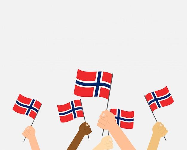 Vetorial, ilustração, de, mãos, segurando, noruega, bandeiras Vetor Premium
